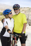 Senior Couple Standing By Bicycle Royalty Free Stock Images