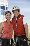 Senior Couple Standing With Bicycles Stock Photo