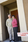 Senior Couple Standing At The Doorway Stock Photos