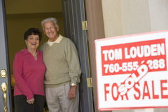 Senior Couple Standing At Doorway Stock Photography