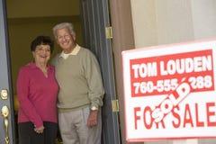 Senior Couple Standing At Doorway Stock Photography