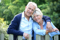Senior couple standing by the fence royalty free stock photography