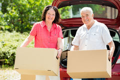 Senior Couple Standing In Front Of Car Royalty Free Stock Photo