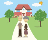 Senior couple standing in front of their house Stock Images