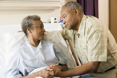 Senior Couple Standing In Hospital Together Royalty Free Stock Photography
