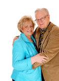 Senior couple standing and hugging. A nice senior couple standing isolated for white background Stock Photo