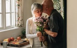 Romantic senior couple at home expressing their love royalty free stock photography