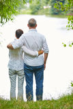 Senior couple standing on a lake Royalty Free Stock Images
