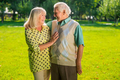 Senior couple is standing outdoor. Stock Image