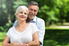 Senior couple standing outdoors. Loving senior couple standing outdoors Royalty Free Stock Images