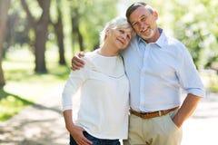 Senior couple standing outdoors. Loving senior couple standing outdoors Royalty Free Stock Photo