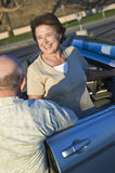 Senior Couple Standing Outside Convertible Royalty Free Stock Photography