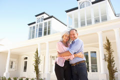 Senior Couple Standing Outside Dream Home Royalty Free Stock Photo