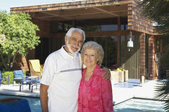 Senior Couple Standing Outside House Stock Photo