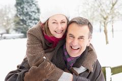 Senior Couple Standing Outside In Snowy Landscape Stock Image