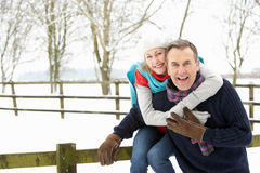 Senior Couple Standing Outside In Snowy Landscape Stock Images