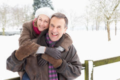 Senior Couple Standing Outside In Snowy Landscape Stock Photos