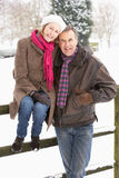 Senior Couple Standing Outside In Snowy Landscape Royalty Free Stock Photography