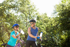 Senior couple standing with their bikes. In a forest Royalty Free Stock Image