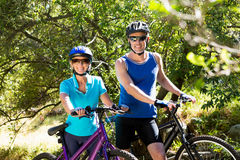 Senior couple standing with their bikes Stock Images