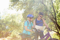 Senior couple standing with their bikes. In a forest Royalty Free Stock Photos