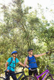 Senior couple standing with their bikes. In a forest Royalty Free Stock Photography