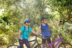 Senior couple standing with their bikes. In a forest Stock Image