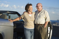 Senior Couple Standing Together By Car Stock Images
