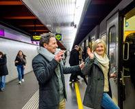 Senior couple standing at the underground platform, entering tra Stock Images