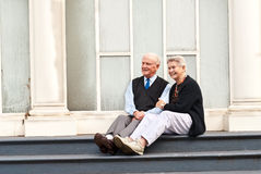 Senior Couple on Steps Stock Image