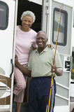 Senior couple on steps of a caravan Royalty Free Stock Photo