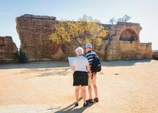Senior couple at Stone necropolis in Valley of Temples Agrigento stock photo