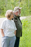 Senior couple stopping along the road Stock Images