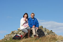 Senior Couple Stopping For Lunch On Countryside Walk Stock Photography