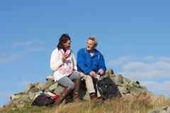 Senior Couple Stopping For Lunch On Countryside Walk royalty free stock photography