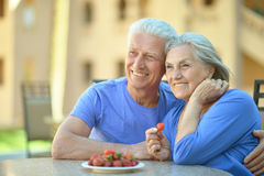 Senior couple  with strawberries Stock Images