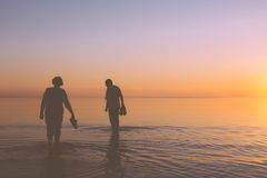 Senior couple strolling at sunset Royalty Free Stock Photos