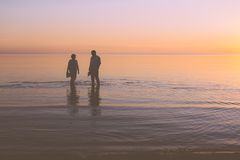 Senior couple strolling at sunset Stock Photography