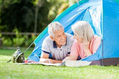 Senior Couple Studying Map In Tent At Park Stock Photos