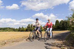 Senior couple at summer bike trip Stock Photos