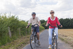 Senior couple at summer bike trip Royalty Free Stock Photo