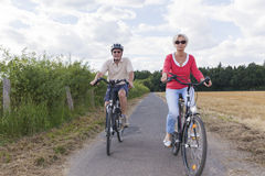 Senior couple at summer bike trip Royalty Free Stock Photos