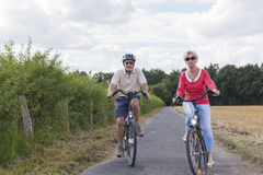 Senior couple at summer bike trip Royalty Free Stock Image