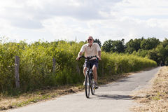 Senior couple at summer bike trip Stock Images
