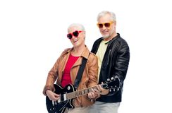 Senior couple in sunglasses with electric guitar Royalty Free Stock Images