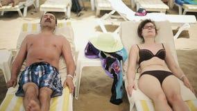 Senior couple sunning at the beach stock footage