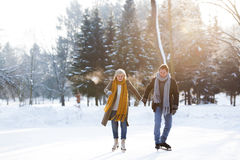 Senior couple in sunny winter nature ice skating. Stock Photography