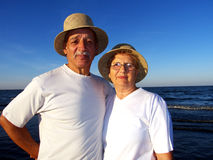 Senior couple at sunset on the beach Stock Image
