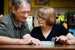 Senior couple with daily supplements Royalty Free Stock Photography