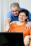 Senior couple surfing Internet Stock Photos